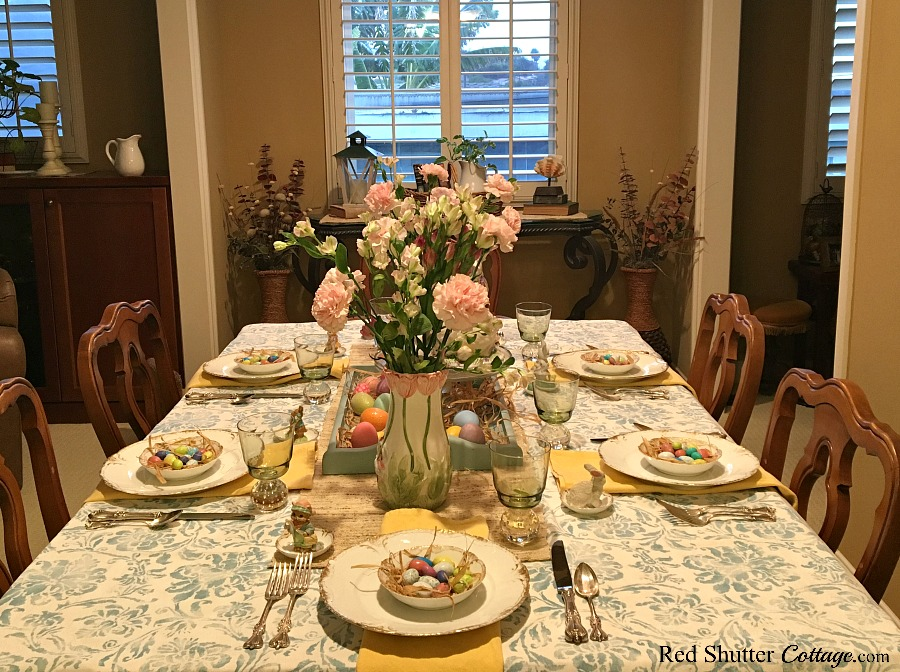 From the kitchen is a view of a whimsical Spring/Easter table setting. www.redshuttercottage.com