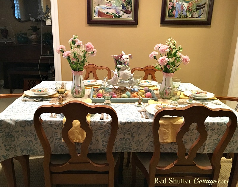 This is front view of a whimsical Spring or Easter table setting. www.redshuttercottage.com