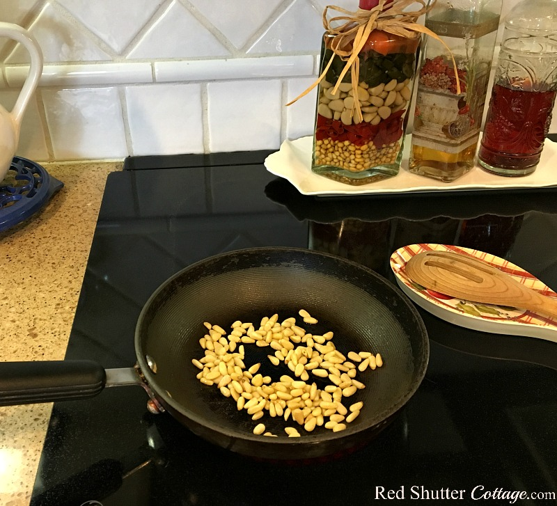 Begin the process of toasting pine nuts for the Mediterranean Chicken Salad. www.redshuttercottage.com