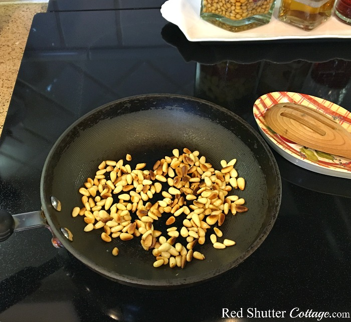 Toast the pine nuts until they are brown, stirring frequently, for the Mediterranean Chicken salad. www.redshuttercottage.com