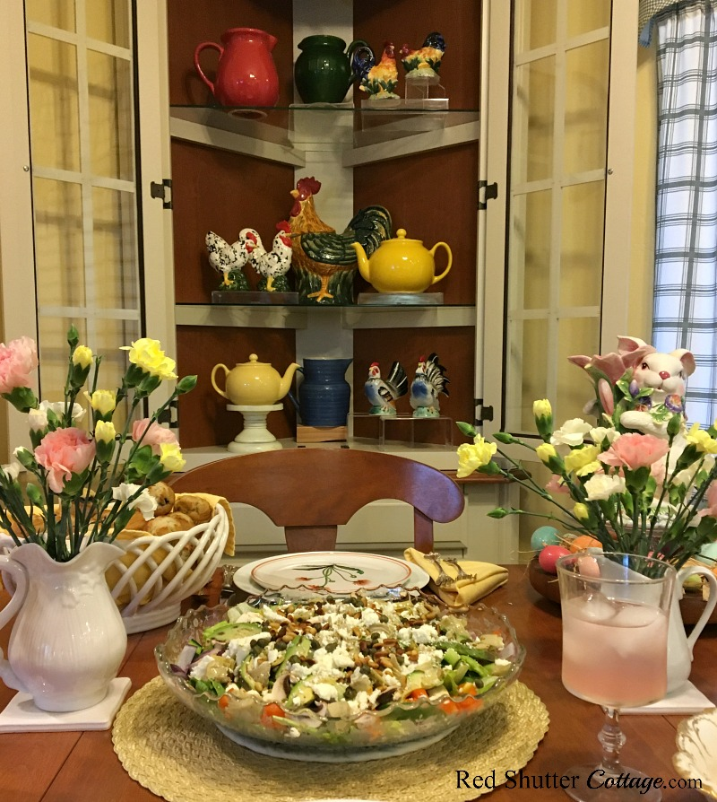 The Mediterranean Chicken salad sits in the center of this festive Easter table. www.redshuttercottage.com