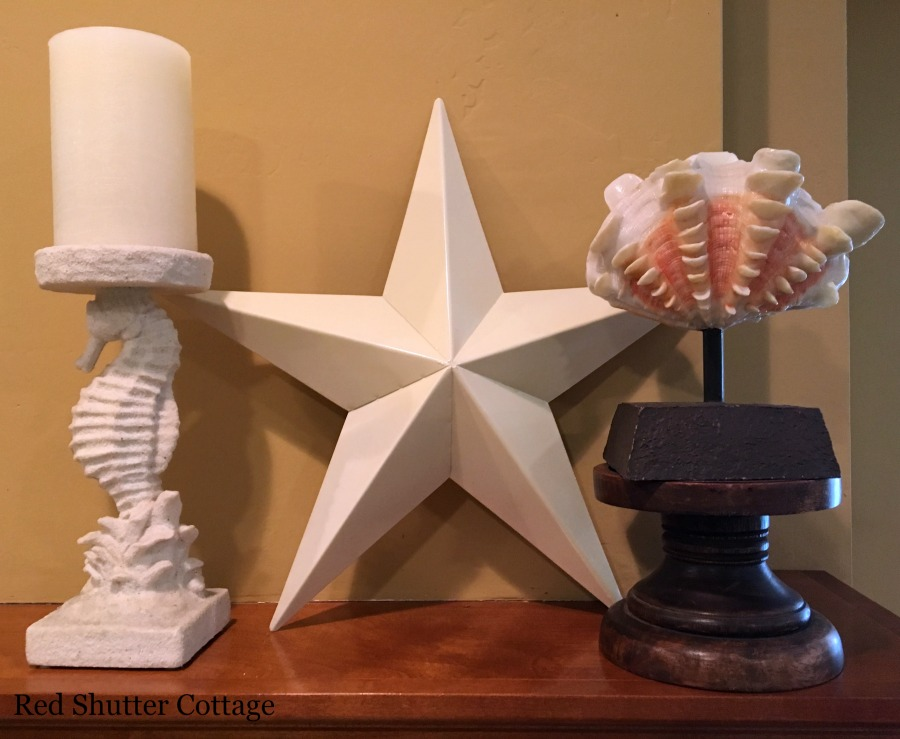 Summer mantel with Sea Horse Candleholder, star and shell on a stick. How to Decorate a Summer Mantel.