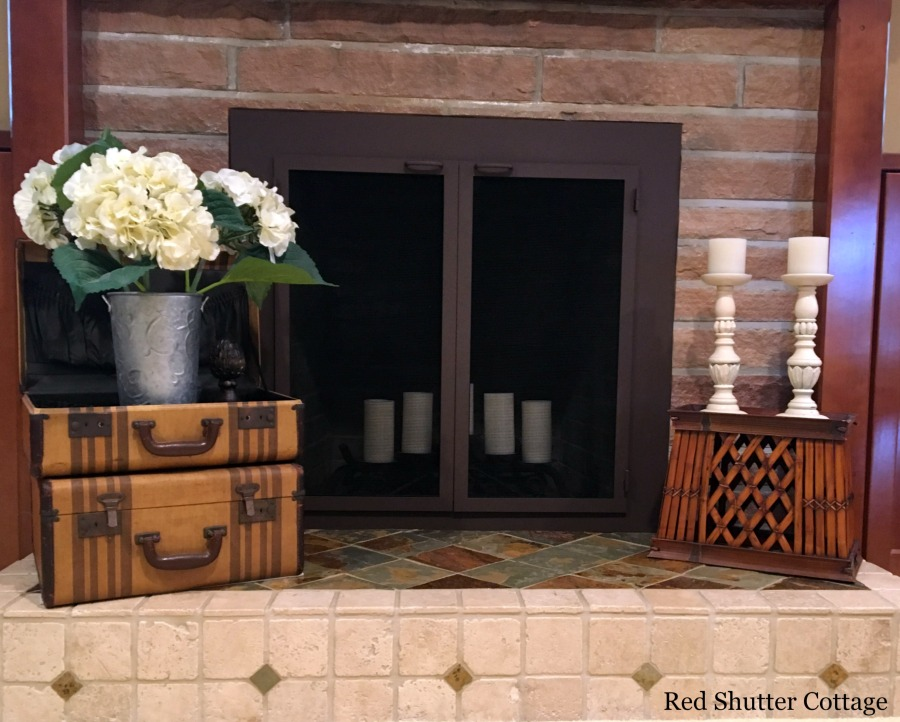 A summer hearth with hydrangeas & candles. How to Decorate a Summer Mantel.