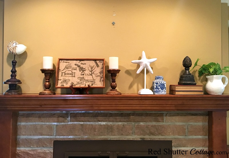 A mantel with a collection of items, part of 5 Steps to a Beautiful Mantel. www.redshuttercottage.com