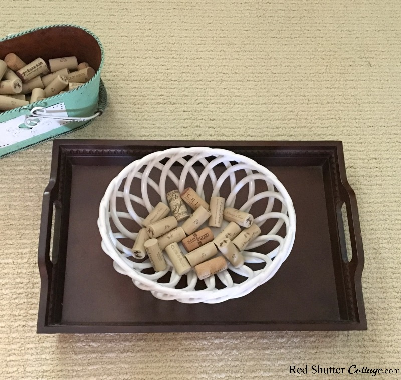 The first layer of wine corks in the shell bowl for the Summer Coffee Table. www.redshuttercottage.com