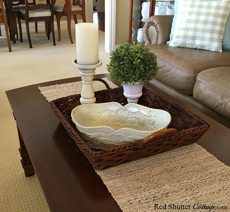 Adding a topiary to the new basket for the Summer Coffee Table. www.redshuttercottage.com