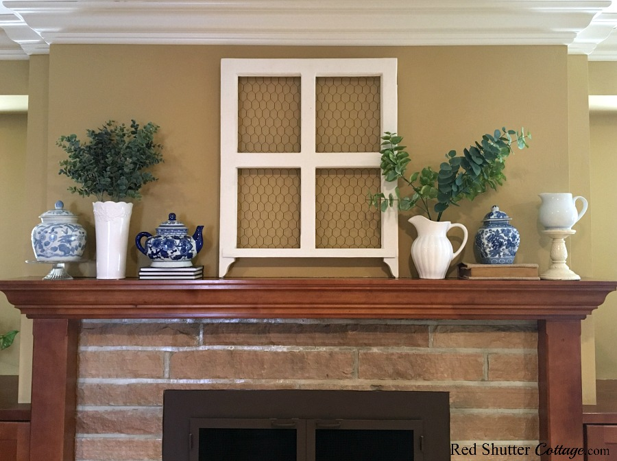 Using 3 complementary colors helps make this mantel display balanced and cohesive, as part of the 5 Steps to a Beautiful Mantel. www.redshuttercottage.com