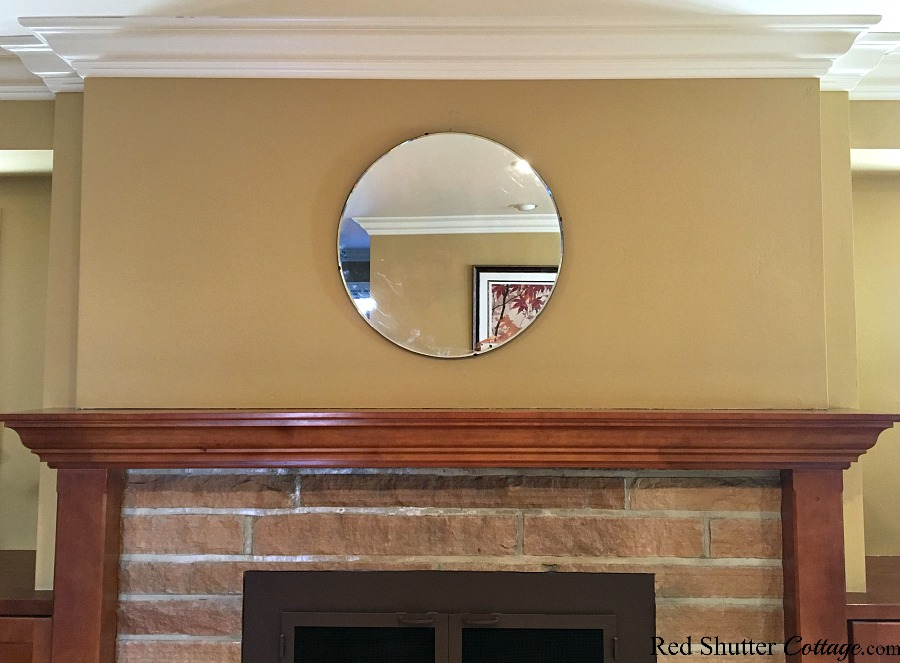 Use a mirror over a mantel to create a focus point, has part of 5 Steps to a Beautiful Mantel. wwwredshuttercottage.com