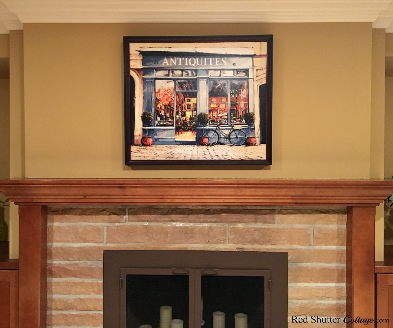 Hang a painting over a mantel to create a focus point, as part of 5 Steps to a Beautiful Mantel. www.redshuttercottage.com