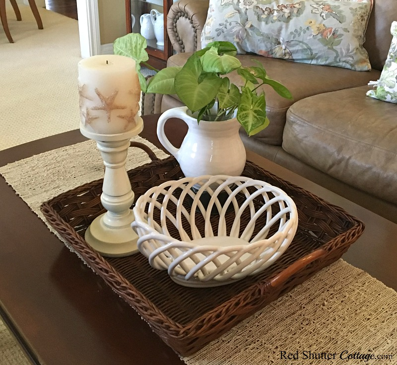 The starfish candle with the new basket on the Summer Coffee Table. www.redshuttercottage.com