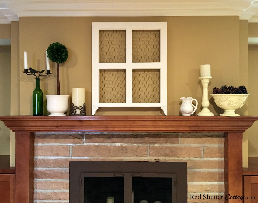 A mantel display showing no real symmetry, as part of 5 Steps to a Beautifu Mantel. www.redshuttercottage.com
