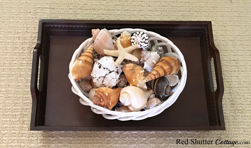 "Top layer of ""showy"" shells going into the shell bowl as part of the Summer Coffee Table vignette. www.redshuttercottage.com"