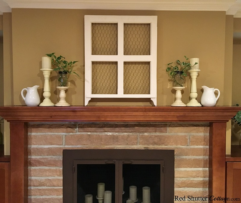 When a mantel has symmetry, the focus and balance are visually pleasing, as part of 5 Steps to a Beautiful Mantel. www.redshuttercottage.com