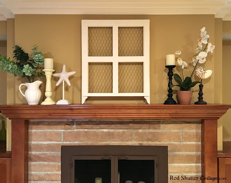 This shows a more relaxed, casual symmetry, that is still visually pleasing, as part of 5 Steps to a Perfect Mantel. www.redshuttercottage.com