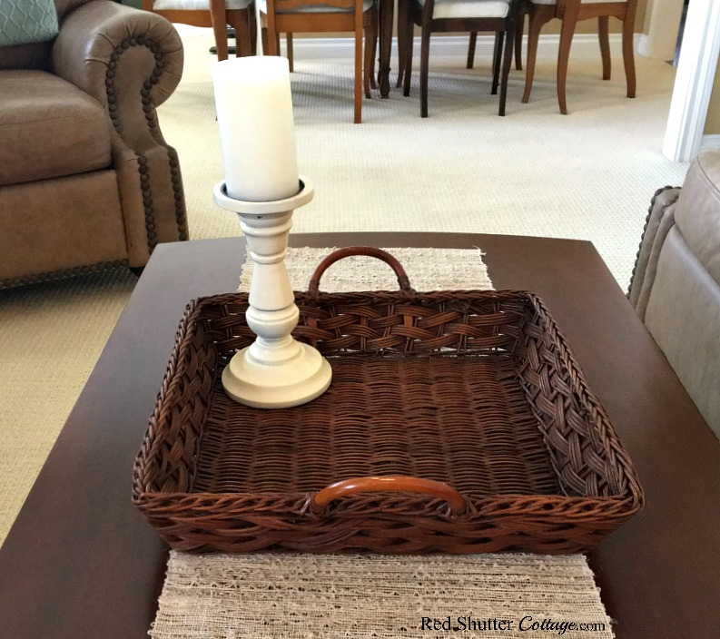 A candle on the new basket starts the vignette for the Summer Coffee Table. www.redshuttercottage.com