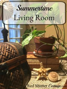 A bright and easy summer living room, filled with shells, plants and books. www.redshuttercottage.com