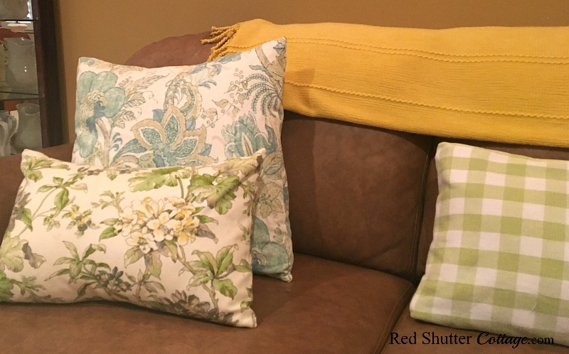 A close-up of summer fabric pillows in a bright and easy summer living room. www.redshuttercottage.com