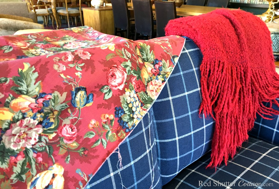 A combination of a red throw, chintz fabric and the blue love seat-The Love Seat I Almost Didn't Buy. www.redshuttercottage.com