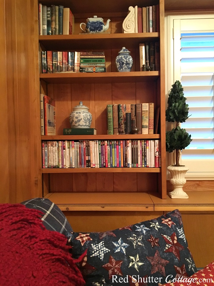 A view of The Love Seat I Almost Didn't Buy and the left bookcase in the TV Room. www.redshuttercottage.com