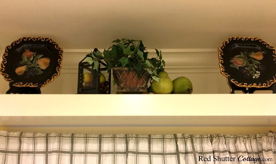 The spring version of how to decorate a plate shelf above the sink. www.redshuttercottage.com