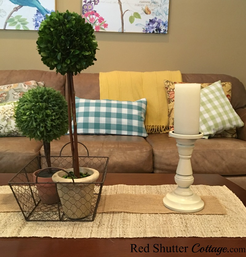 Summer living room couch with coffee table topiaries. www.redshuttercottage.com