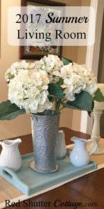 Summer living room dining table with hydrangeas. www.redshuttercottage.com