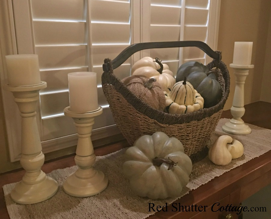 A collection of neutral colored pumpkins as part of styling window countertops for fall. www.redshuttercottage.com