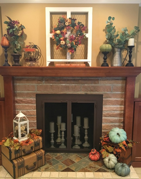 The fireplace and mantel for the 2018 Fall Living Room is a combination of colors, textures and fall elements, including a variety of pumpkins in different colors. www.redshuttercottage.com