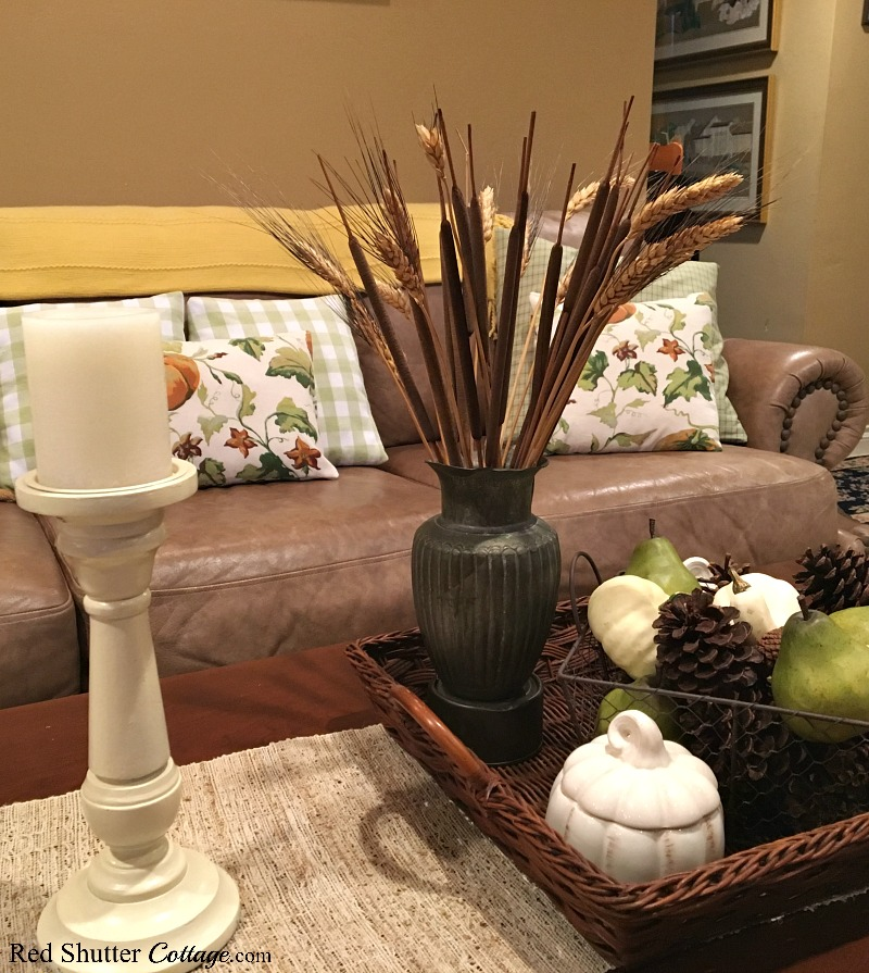 Pumpkins on the pillows, pumpkins on the coffee table, create a warm and cozy feel for the 2018 Fall Living Room tour. www.redshuttercottage.com