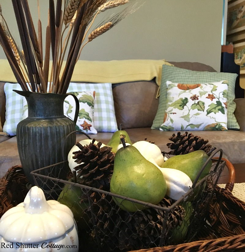 For my 2018 Fall Living Room, I filled the couch with pillows covered in fall colors and prints. www.redshuttercottage.com