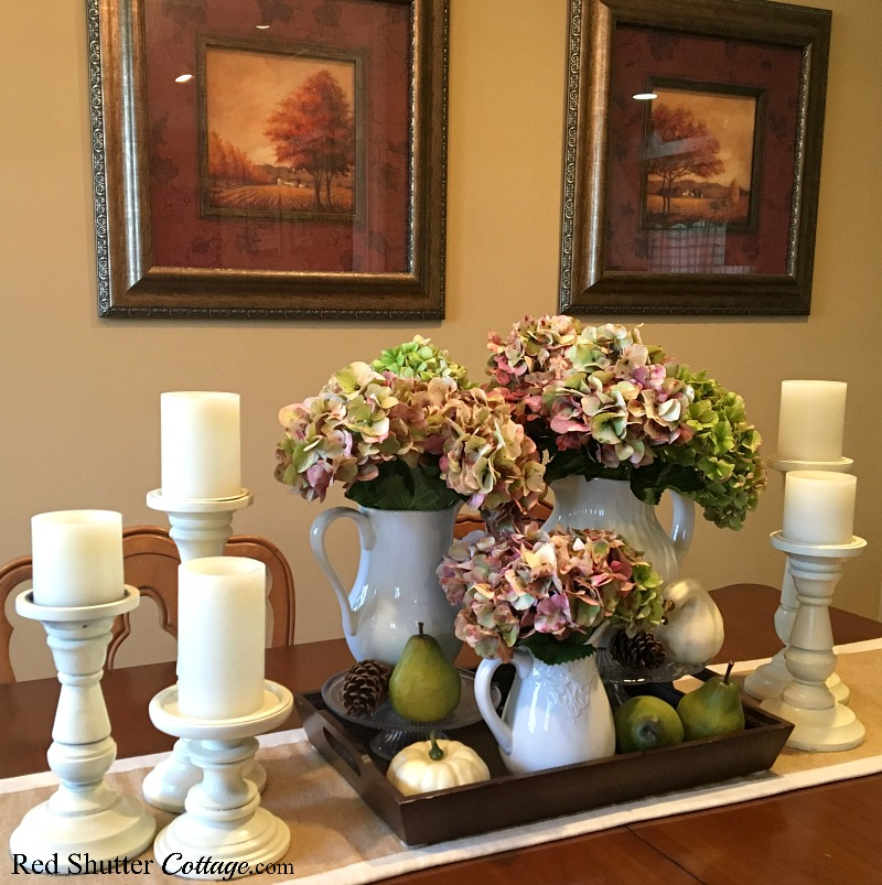 This side view of hydrangeas stacked on cake pedestals is an idea for how to decorate using alternative fall colors. www.redshuttercottage.com