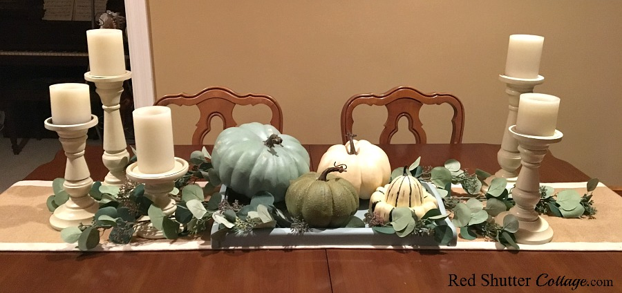 These fall pumpkins with white candles are showing how to decorate with alternative fall colors. www.redshuttercottage.com