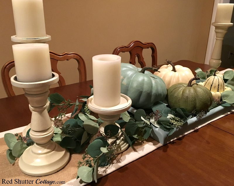 How to decorate using alternative fall colors includes pumpkins with eucalyptus leaves. www.redshuttercottage.com