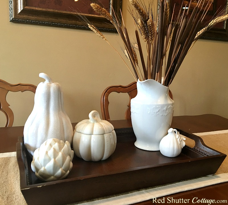 This collection of white ceramic fruits and veggies is part of how to decorate using alternative fall colors. www.redshuttercottage.com
