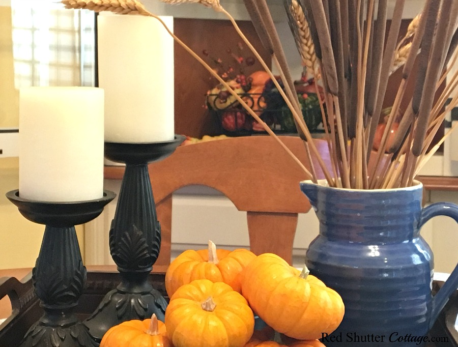 Candles, pumpkins and a blue pitcher are all part of A Simple Fall Vignette - 5 Ways. www.redshuttercottage.com