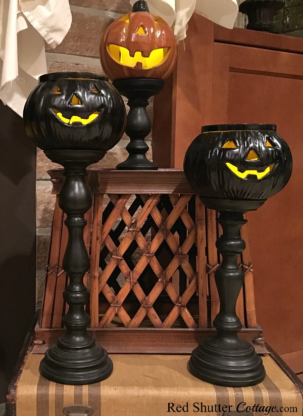 A trio of jack-o'-lanterns on the hearth of a Fun Halloween Mantel. www.redshuttercottage.com