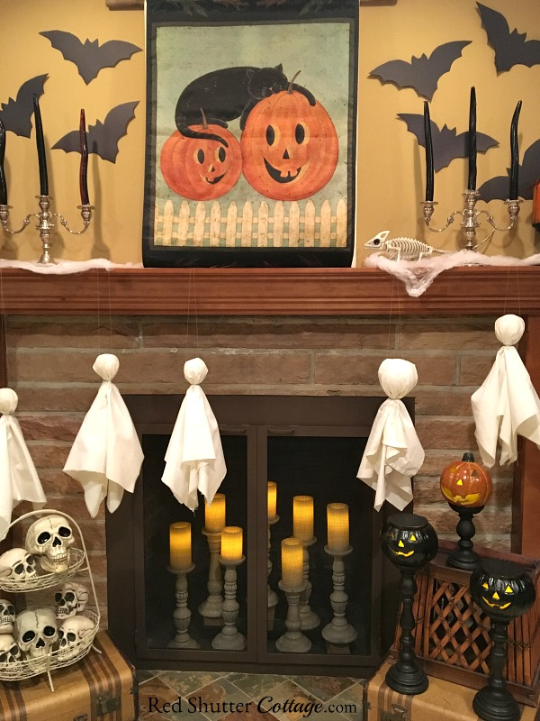 Candles, bats and ghosts are all part of the Fun Halloween Mantel. www.redshuttercottage.
