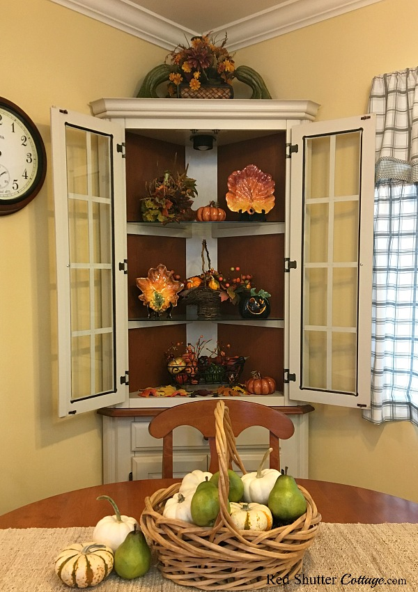 Fall in the Kitchen 2018 includes our breakfast table and hutch decorated with fall colors, leaves, pumpkins and fall fruits and berries. www.redshuttercottage.com
