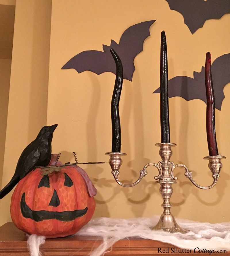 A jack-o'-lantern, candles and bats are part of Fun Halloween Mantel. www.redshuttercottage.com