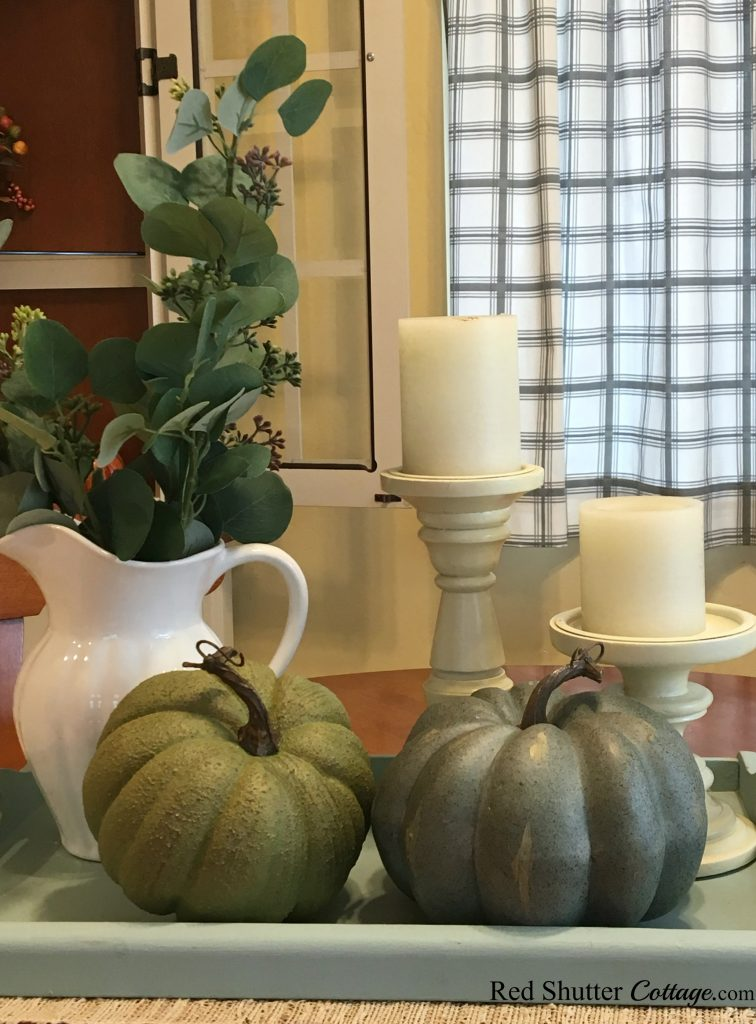 Neutral pumpkins with candles is one version of A Simple Fall Vignette - 5 Ways. www.redshuttercottage.com