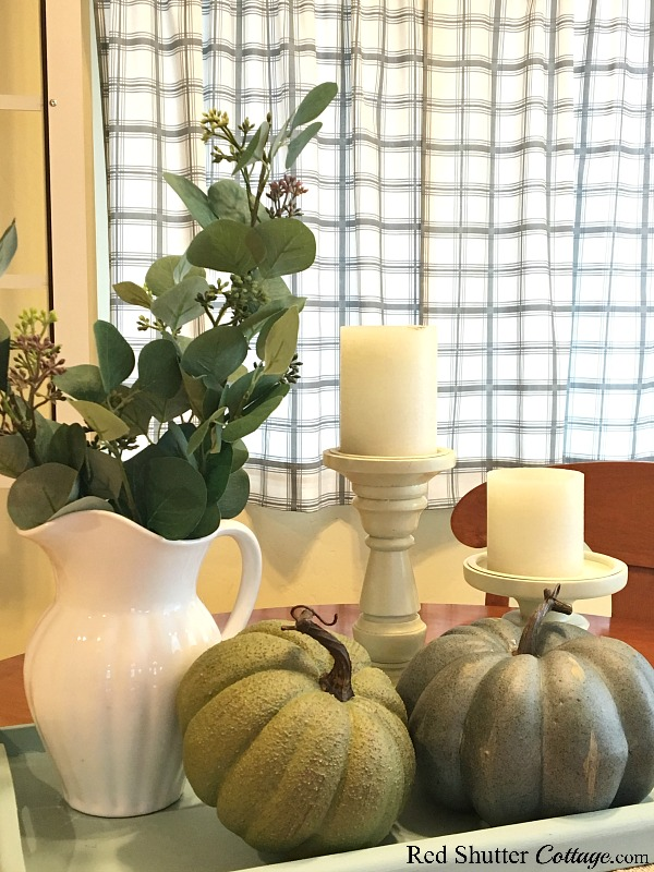 This white pitcher with eucalyptus leaves is part of the variety of A Simple Fall Vignette - 5 Ways. www.redshuttercottage.com