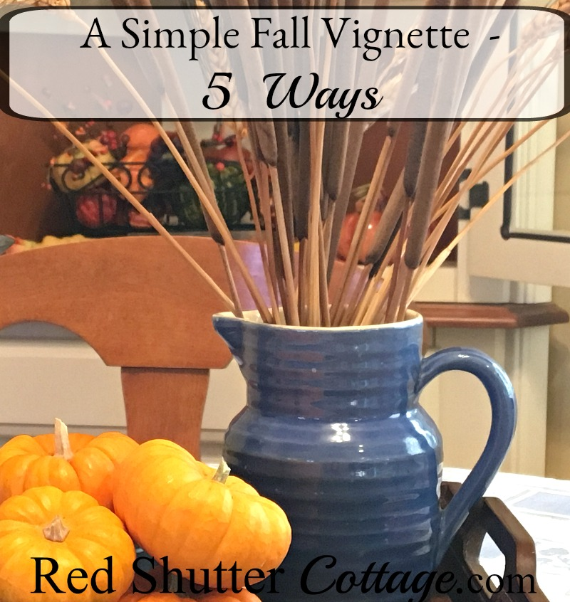 A blue pitcher with wheat is part of A Simple Fall Vignette - 5 Ways. www.redshuttercottage.com