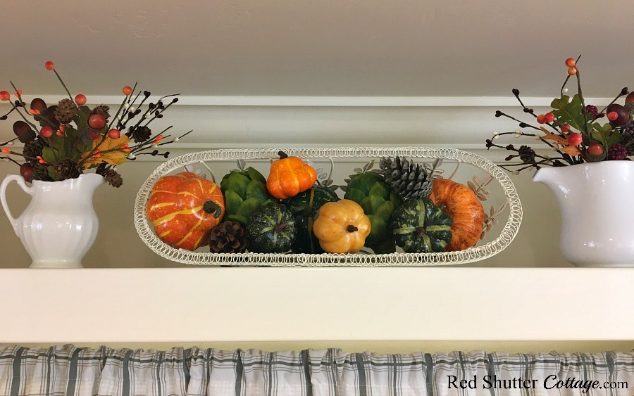The plate shelf above the sink is festively decorated for Fall in the Kitchen 2018. www.redshuttercottage.com