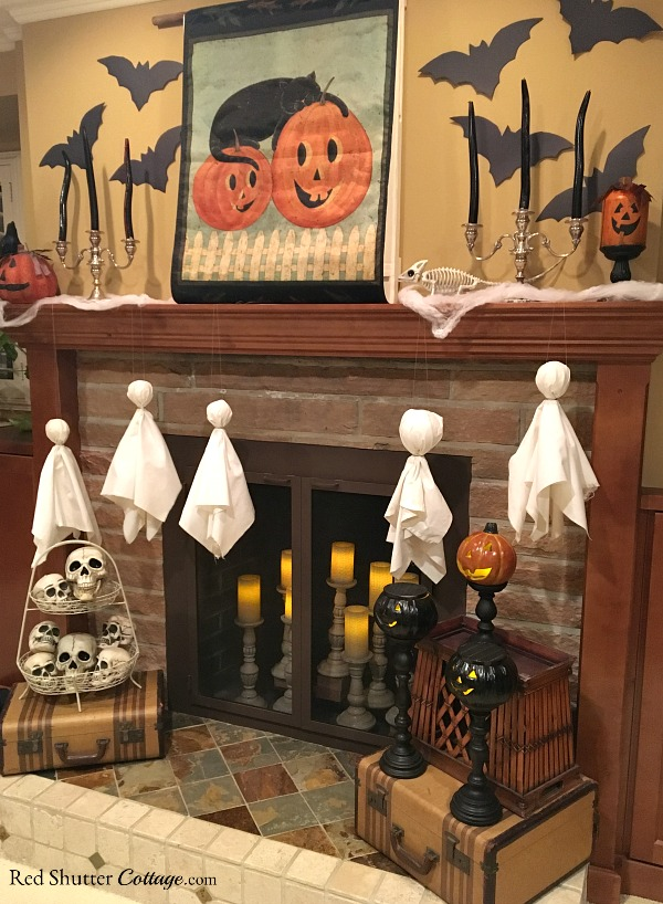 A Fun Halloween Mantel includes bats and candles and ghosts on the mantel. www.redshuttercottage.com