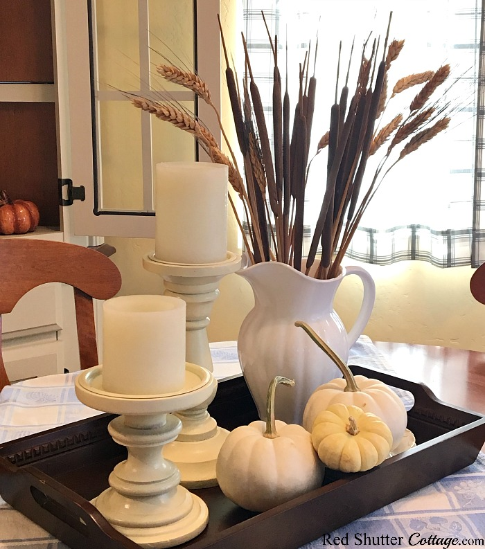 A sheaf of wheat in a white pitcher is one version of A Simple Fall Vignette - 5 Ways. www.redshuttercottage.com