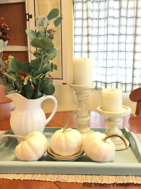 Eucalyptus leaves in a white pitcher are part of A Simple Fall Vignette - 5 Ways. www.redshuttercottage.com