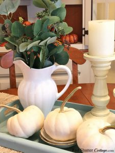 This turquoise tray holds white pumpkins and a white pitcher filled with eucalyptus leaves as part of A Simple Fall Vignette - 5 Ways. www.redshuttercottage.com
