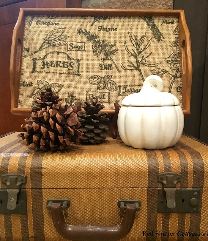 A tray and pinecones sitting on top of suitcases is part of 2018 Thanksgiving Mantel. www.redshuttercottage.com