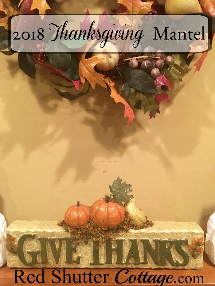 The 2018 Thanksgiving Mantel includes turkeys and pumpkins. www.redshuttercottage.com