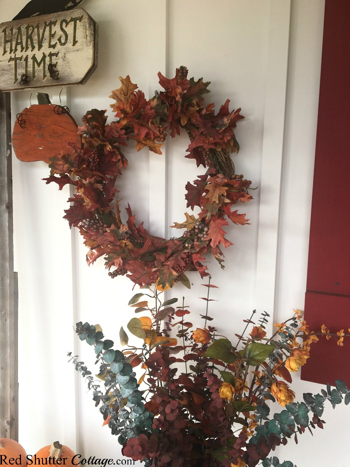 The Harvest Time sign as part of the grouping in A Festive Fall on the Front Porch. www.redshuttercottage.com